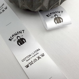 Custom printed labels with a logo and care instructions and care symbols