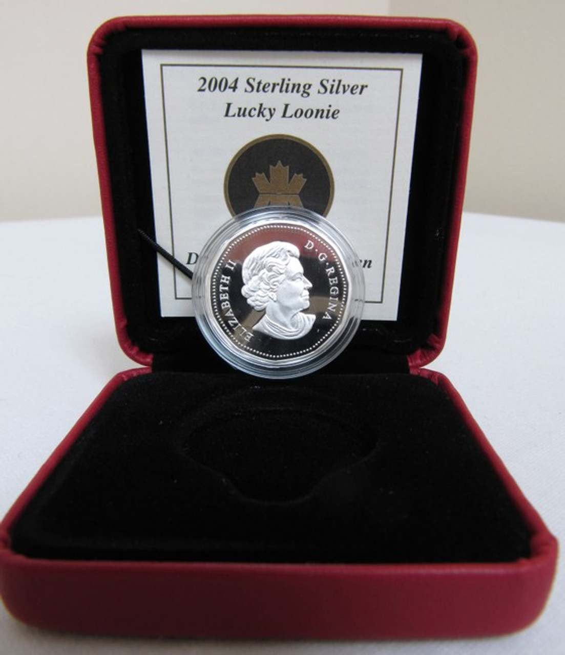 2004 SPECIAL EDITION OLYMPIC LUCKY LOONIE $1 FIRST DAY STRIKE