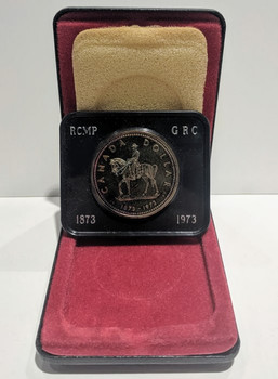 1973 SPECIMEN COMMEMORATIVE SILVER DOLLAR - ROYAL CANADIAN MOUNTED POLICE (TONED)