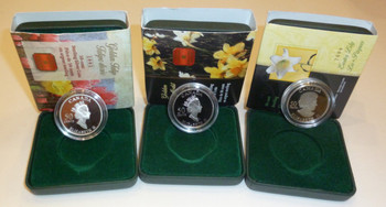 3 GOLD PLATED STERLING SILVER 50-CENT COINS - 2002 TULIP - 2003 DAFFODIL - 2004 EASTER LILY