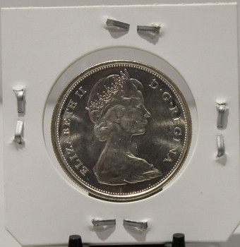 1967 COMMEMORATIVE CENTENNIAL CIRCULATION 50-CENT COIN - .8000 SILVER - UNGRADED - AS PICTURED