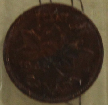1945 CIRCULATION ONE-CENT COIN - RED AND BROWN - MS-63