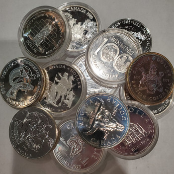 10 MIXED CANADIAN SILVER DOLLARS (1971-1991) (3.75oz. SILVER)