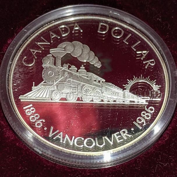 1986 PROOF COMMEMORATIVE SILVER DOLLAR - VANCOUVER CENTENNIAL