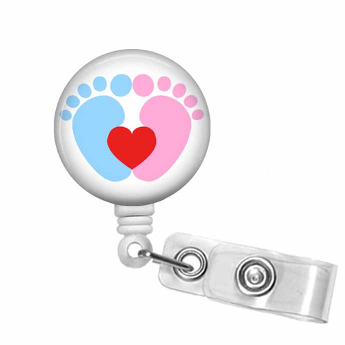 Tiny baby feet in pink and blue with red heart on white badge reel