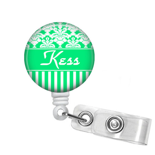 Green and white damask and striped design on a white badge reel from Badge Reel Boutique