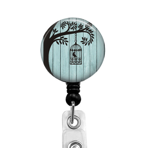 Bird in Cage Badge Reel