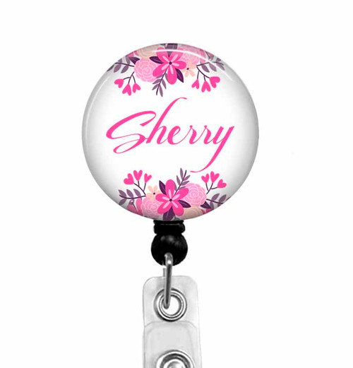 Name badge reel with pink flowers