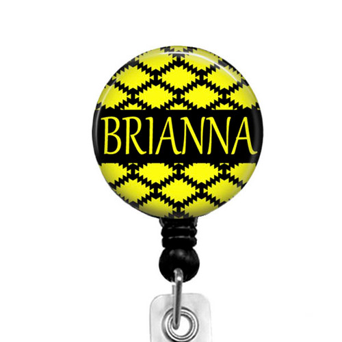 A cute yellow and black badge reel, personalized with your name and is perfect for workers that need to display their identification while at work.