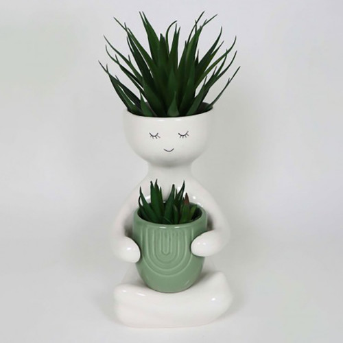Person Holding a Green Pot Planter