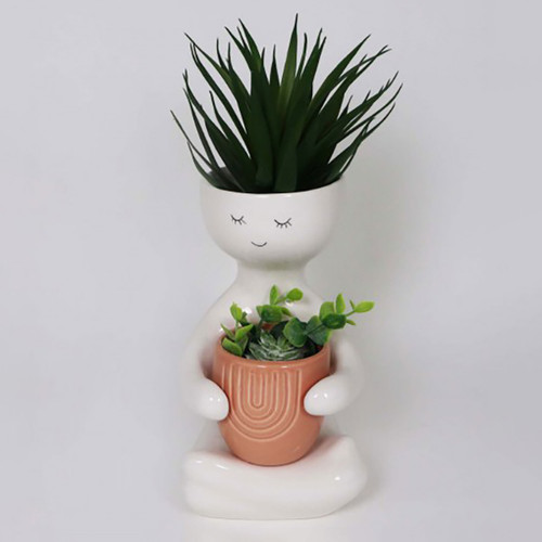 Person Holding a Pink Pot Planter