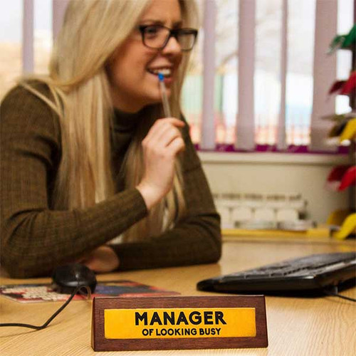 Manager of Looking Busy Desk Sign