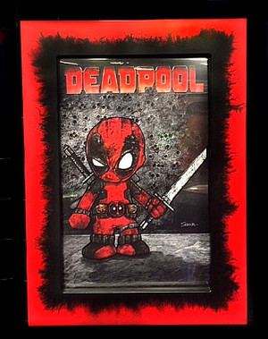 "Frankie Serna Collection; ""Baby Deadpool""  Displayed in 11x17  Black on Red "" Chaos"" Finish Toploader Frame"