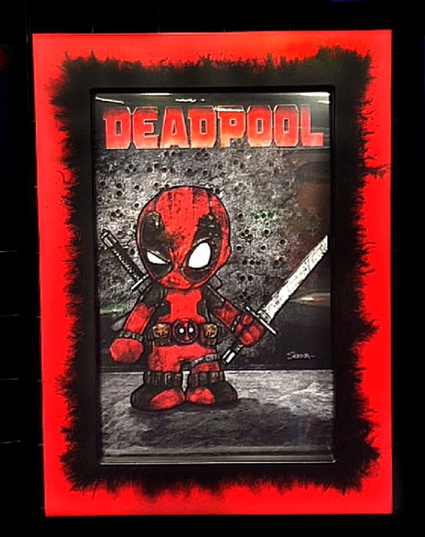 """Frankie Serna Collection; """"Baby Deadpool""""  Displayed in 11x17  Black on Red """" Chaos"""" Finish Toploader Frame"""