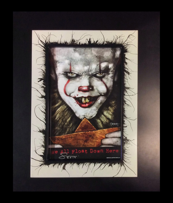 "Frankie Serna Collection; ""PENNYWISE"" displayed in 11 x 17 ""Chaos"" frame"