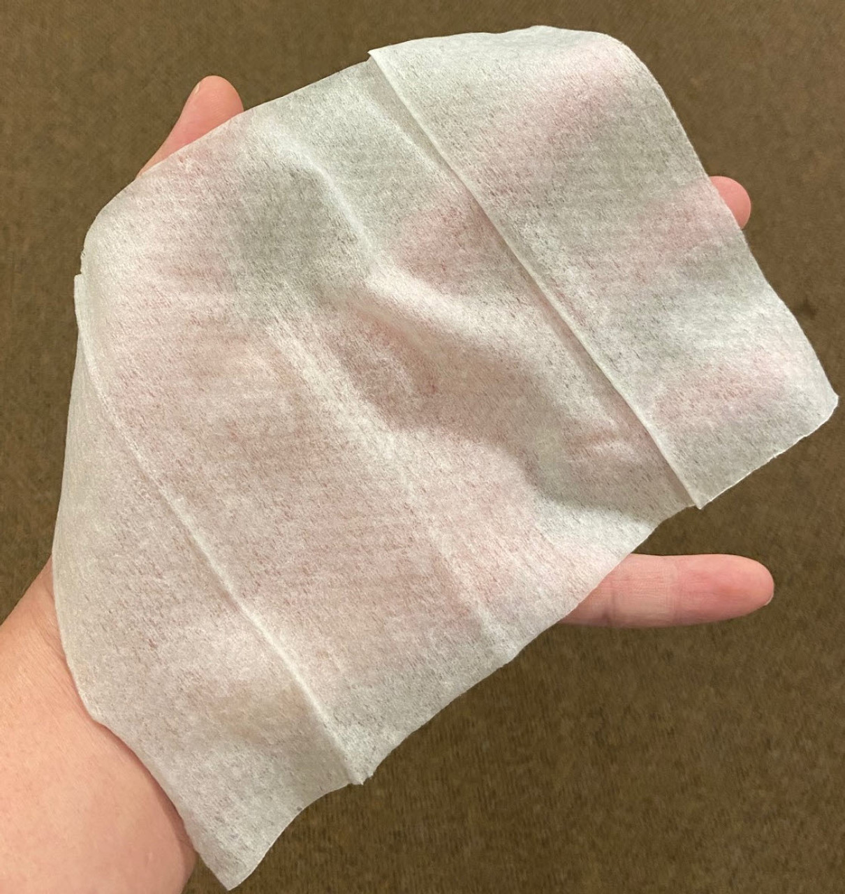 75% Alcohol Wipe in hand