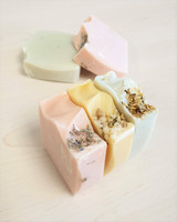 Luxi Buff Soaps, from left to right: pink lavender & himalayan rock salt, yellow lemon & camomile, green peppermint & calendula.