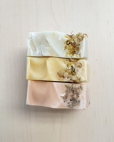 Luxi Buff Soaps, top to bottom: green peppermint & calendula, yellow lemon & camomile, and pink lavender & himalayan rock salt.