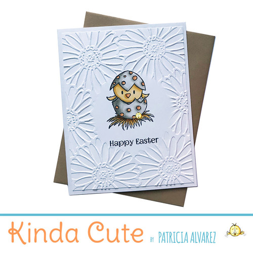 Handmade easter card with a partial embossed front panel in white. An Easter egg with a bird inside is colored in grey and yellow. The sentiment reads Happy Easter.