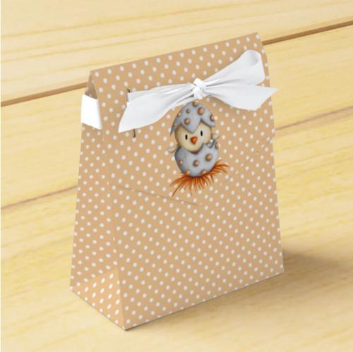 Polka dot orange favor box with a baby bird