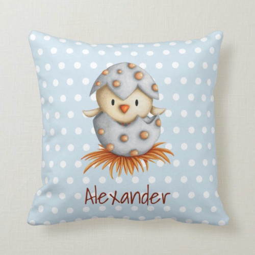 Baby pillow with a bird hatching for nursery decor