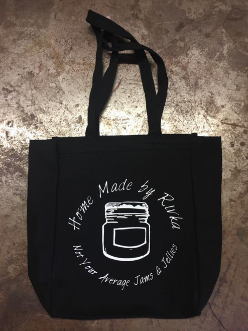 Our black Reusable Canvas Shopping Bag was locally made, and designed with you in mind. This extra large canvas bag features a flat bottom and long handles for easy shopping and comfort.