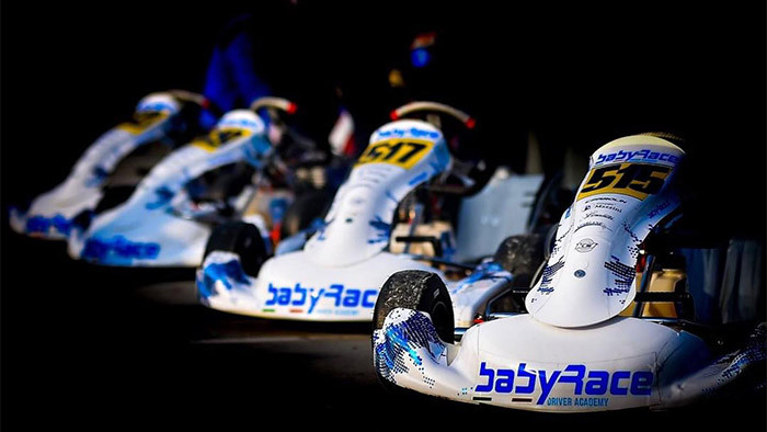 Babyrace karts in a line all with custom white & blue chrome graphics designed by Kartdavid