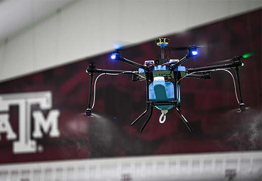 Lucid Drone D1 spraying in a stadium