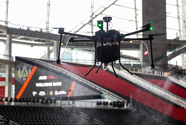 Lucid Drone disinfecting drone sprayingina stadium
