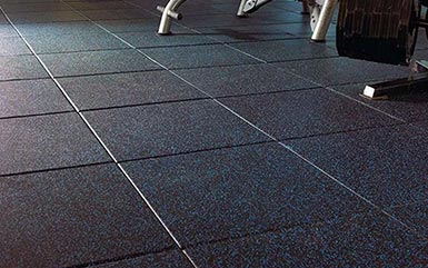 Blue and black speckled rubber flooring tiles from Zogics.