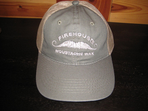 Firehouse Moustache Wax Olive/Tan Embroidered Baseball Cap with mesh back & Velcro closure.