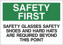 Safety First Sign - Safety Glasses Safety Shoes and Hard Hats Are Required Beyond This Point