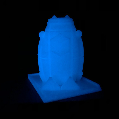 SnoLabs Penguin printed in Glow in the Dark Blue PLA.