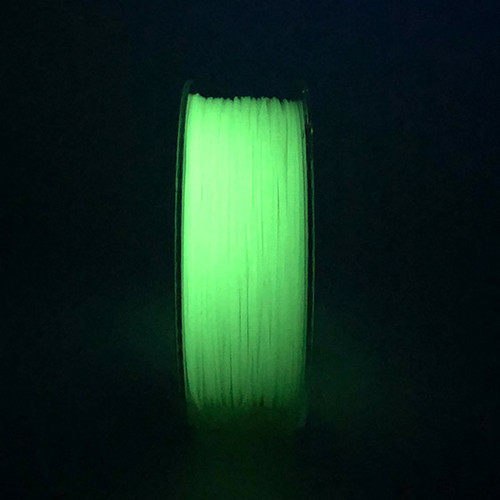 A spool of glow in the dark green pla.