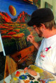Ford Smith at work painting in his studio