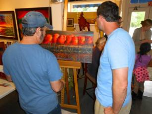 Ford Smith working on new painting at Ashley's Art Gallery