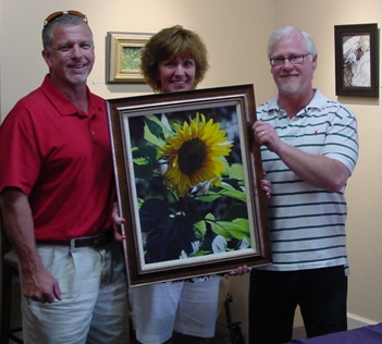 Terry Isaac with art collectors at Ashley's Art Gallery