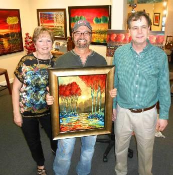 Suzy, Ford and Rick Mullen gallery owner