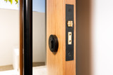 Black roller deadbolt latch entrance door zanda in situation