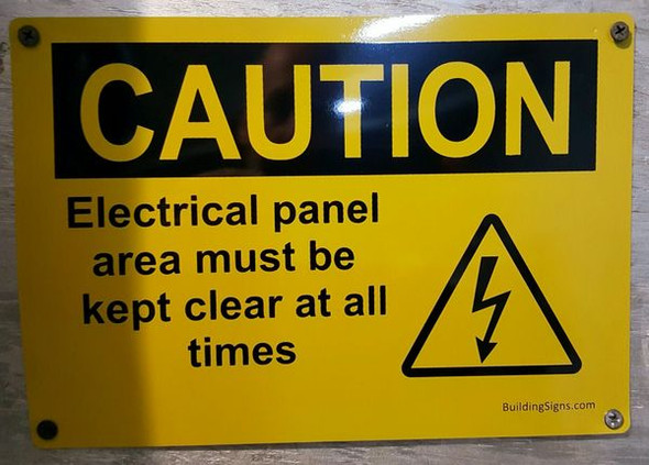 Caution Electrical panel area must be kept clear at all times sign for Building