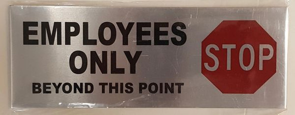 EMPLOYEES ONLY BEYOND THIS POINT STOP SIGN