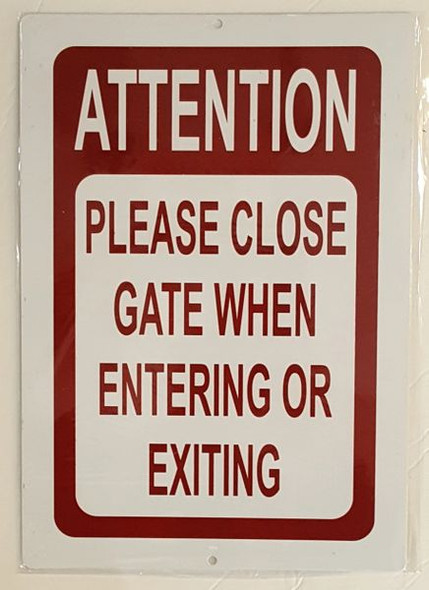 ATTENTION PLEASE CLOSE GATE WHEN ENTERING OR EXITING SIGN for Building