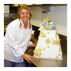 gfbg-st-michaels-store-page-gallery-tricia-with-wedding-cake.jpg