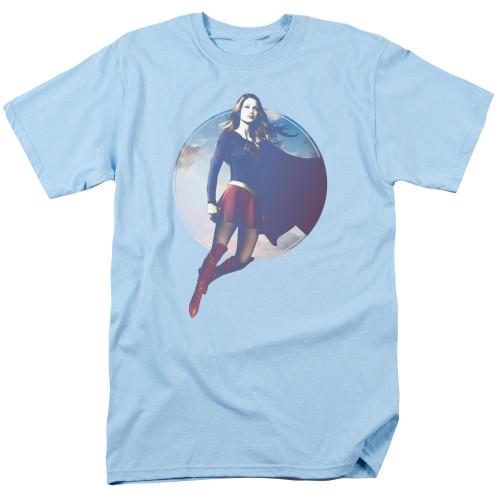 Supergirl Hovering on Light Blue