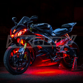 Sports bike illuminated by red single color light kit