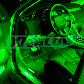 Green single color kit illuminating the interior of a vehicle
