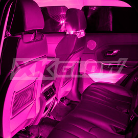 Pink single color kit illuminating the interior of a vehicle