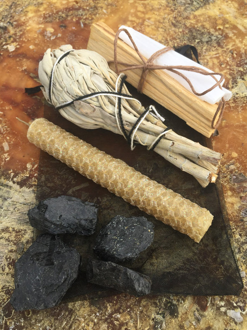 Smudge set with home protection grid. Selenite, black tourmaline, chime candle, white sage, palo santo