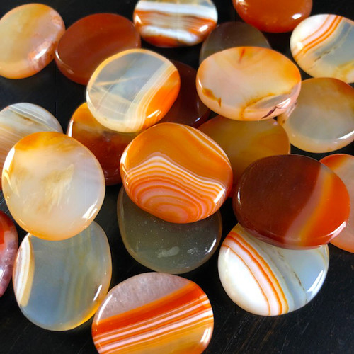 CARNELIAN GEMSTONES ABOUT PALM STONES