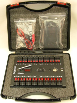 Included is the MS32Q firing system, AA battery case, two keys, external battery jumper, and a plastic carrying case.